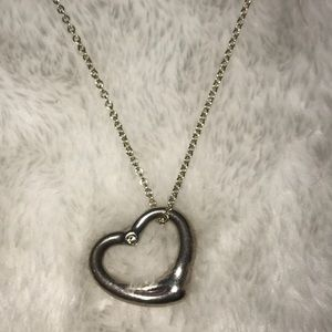 TiffanyandCo Open Heart pendant w/ single diamond